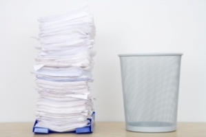 stack-of-papers-and-wastecan